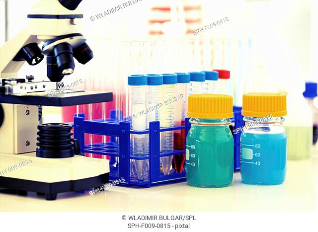 Microscope and chemicals in a laboratory
