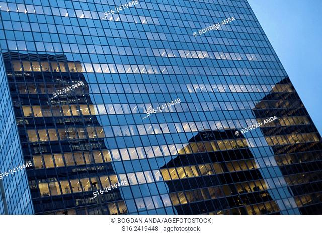 Bruxelles - reflections on office building at dusk