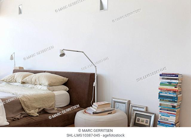 Lamp beside platform bed