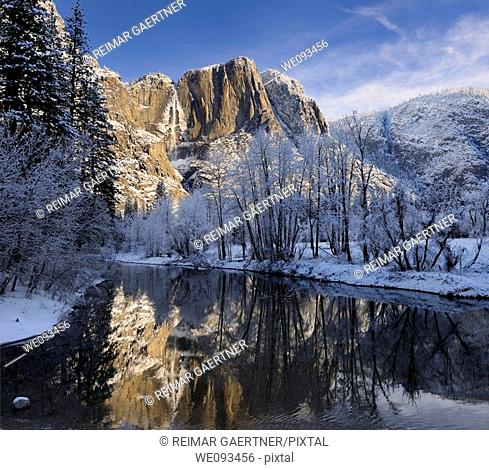 Reflections of Yosemite Point and the Upper Fall in the Merced River with snow covered trees