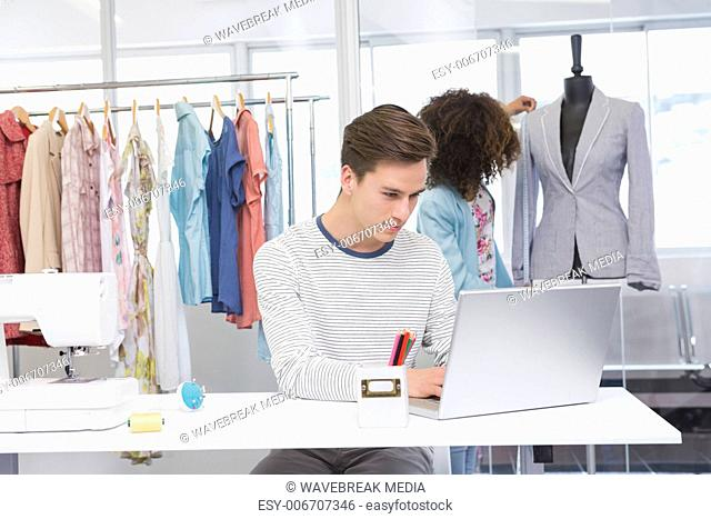 Students working with laptop and model