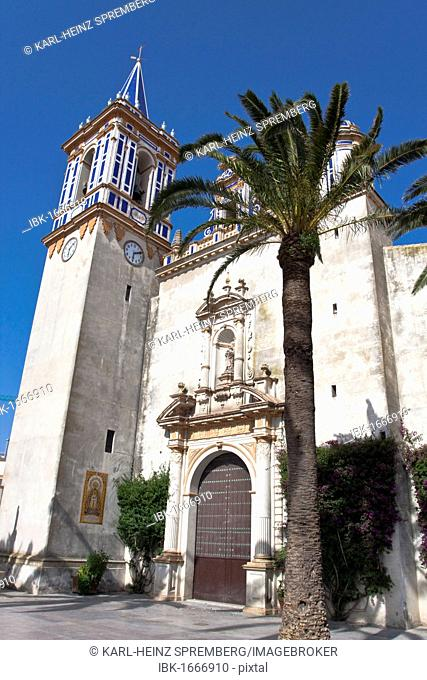 Main entrance with sandstone tower of the church Virgen de Regla in Chipiona, Andalusia, Spain, Europe