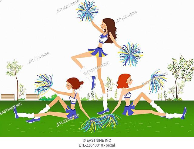 Side profile of three cheerleaders