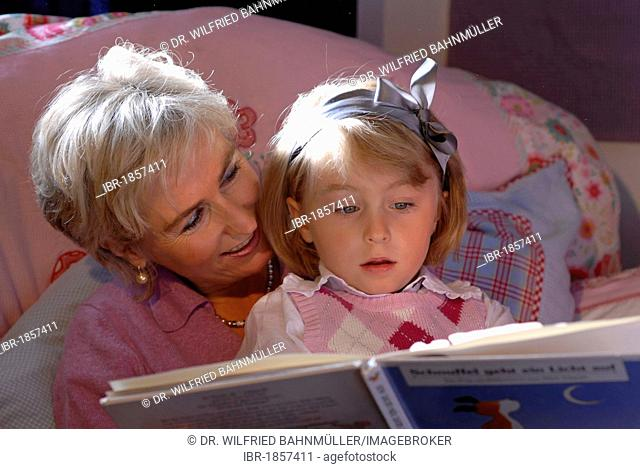 Mother is reading to her daughter