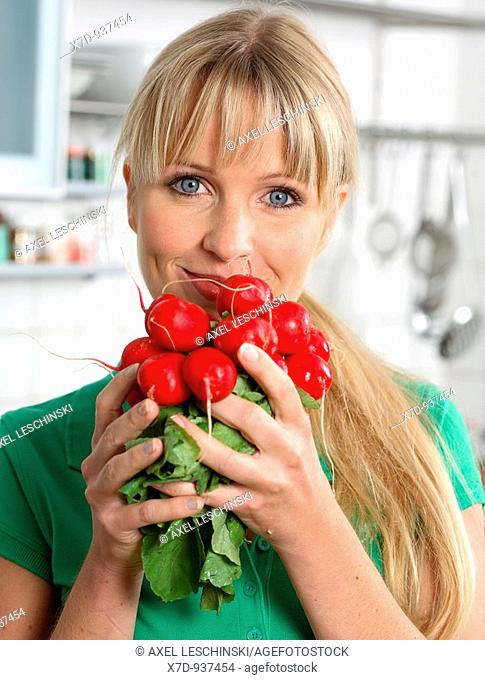Woman eating small red radish