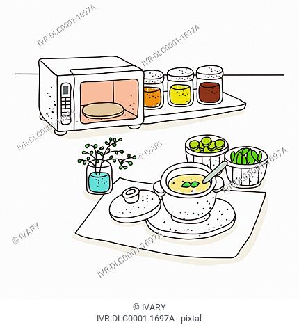 Foodstuff and microwave against white background