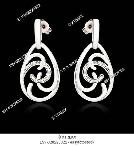 White gold earrings with diamond isolated on the black background