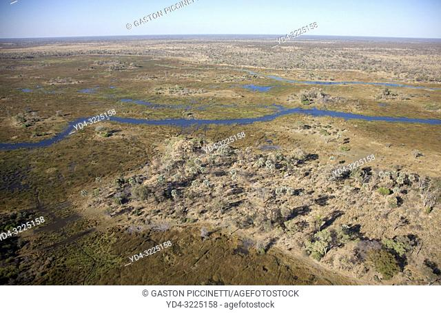 Aerial view of the Okavango Delta, Botswana. The vast inland delta is formed from the Okavango River. This flows into the Delta