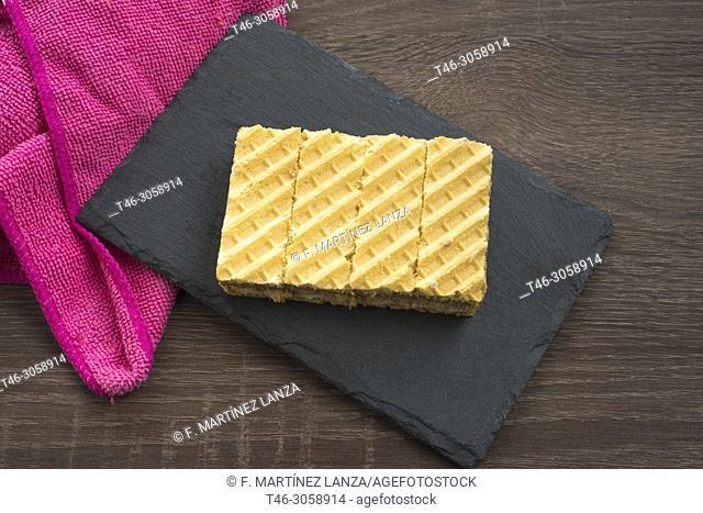 Chocolate cookies and cream on blackboard