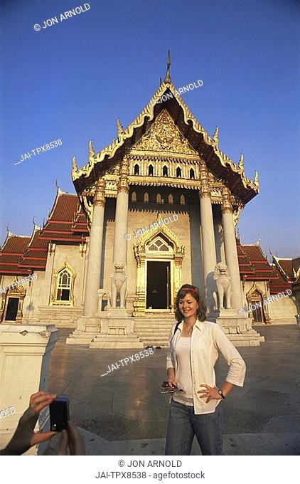 Thailand, Bangkok, Wat Benchamabophit, Tourist Couple Taking Photos in the Marble Temple