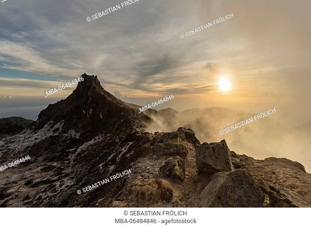 Foggy sunrise at the summit of the Mt. Sibayak, to a volcano on the Indonesian island Sumatra