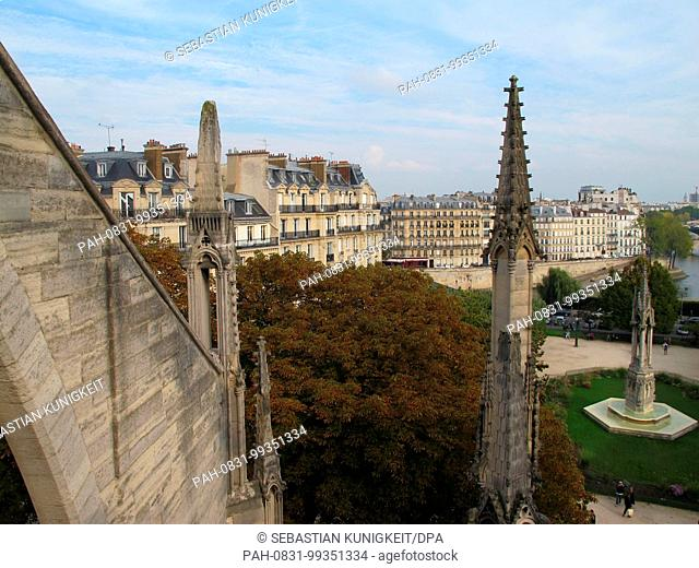 Pinnacles on the Notre-Dame Cathedral, once of which (left) is heavily damaged, in Paris, France, 27 September 2017. The air pollution is causing damage to the...