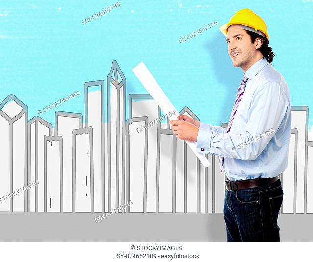 Engineer in front of buildings with a plan
