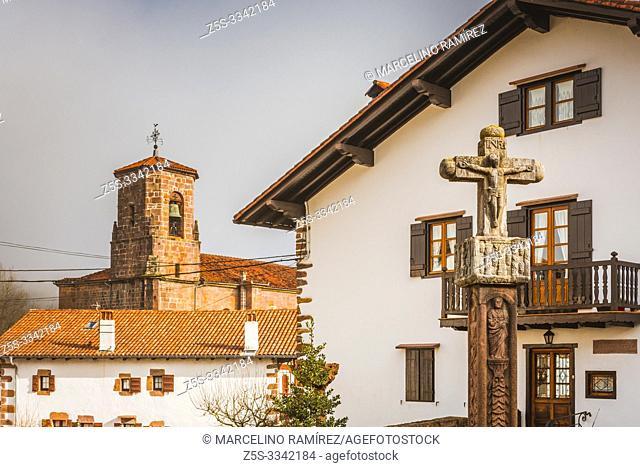 Ancient stone cross on a street in the village of Etxalar. Etxalar, Cinco Villas, Bortziriak,Navarre, Spain, Europe