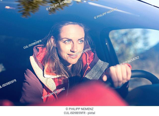 Windscreen view of woman driving car