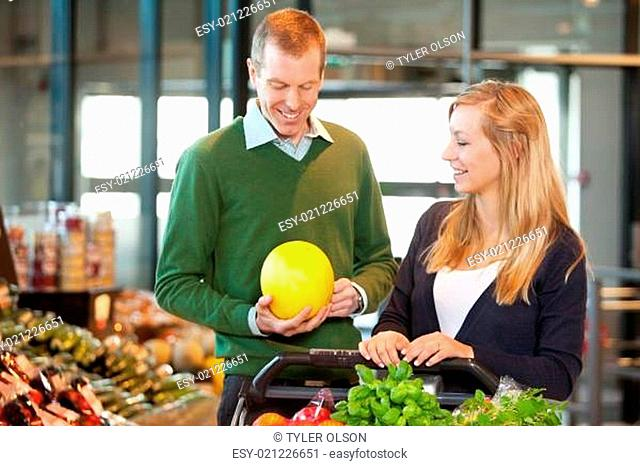 Man and Woman Buying Fruit
