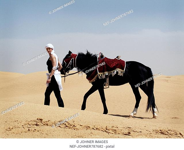 Woman with a horse in the desert, Tunisia