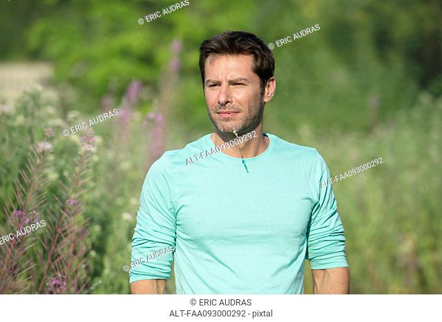 Mature man exploring outdoors, portrait