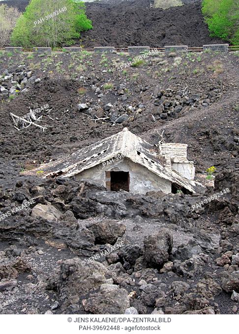 A house is covered with lava from Mount Etna near Zafferana Etnea,Sicily, Italy, 07 May 2013. With a height of 3,323 meters