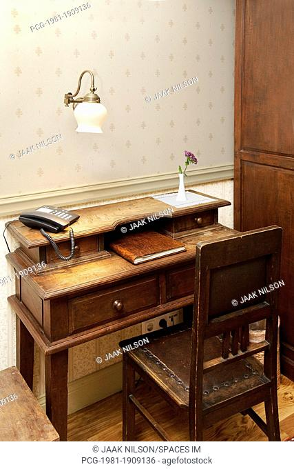 Modern Phone on an Old Fashioned Desk