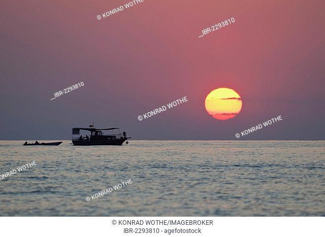 Fishing boat off the Lycian coast at sunset, Lycia, the Aegean, Mediterranean Sea, Turkey, Asia Minor