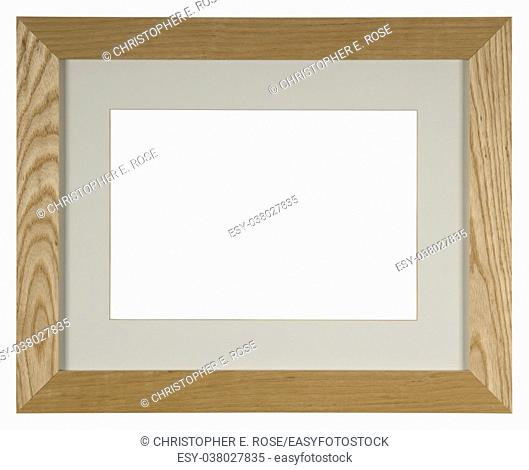 Empty picture frame isolated on white, portrait format with mount in light oak wood