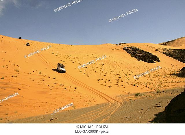 4X4 Vehicles Driving in a Desert Landscape  Namib Desert, Namibia
