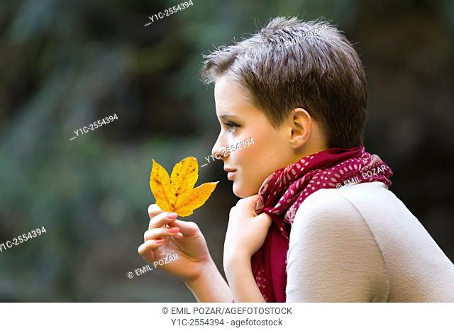 Short-haired teenager girl in woodland