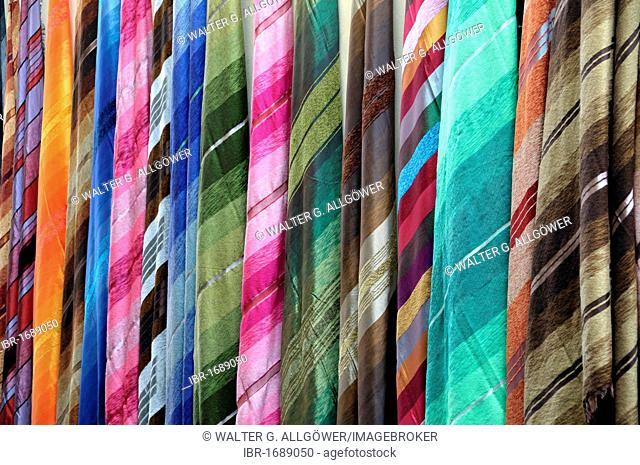 Colored cotton cloths, souk in Fez, Morocco, Africa