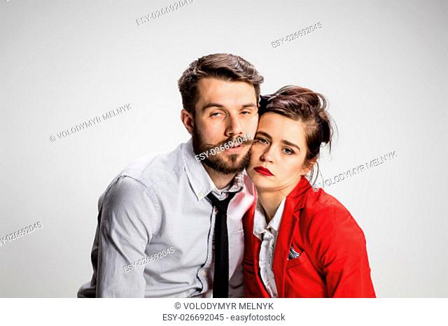 The weary business man and woman on a gray background