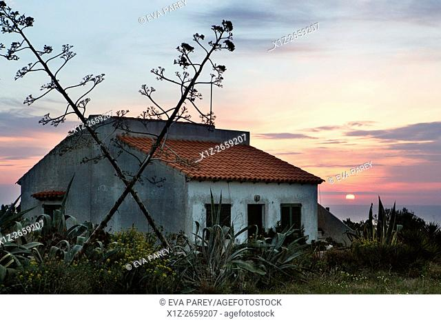 A house close to the lighthouse of La Mola during sunrise. Formentera (Balearic Islands)
