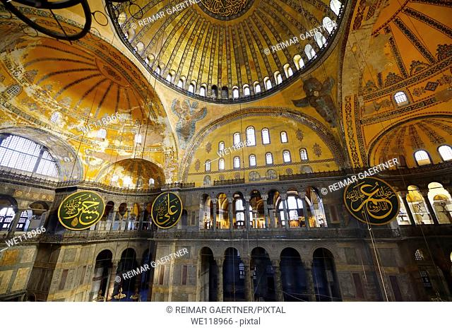 Golden domes frescoes and six winged Saraphim in the Hagia Sophia with wood roundels
