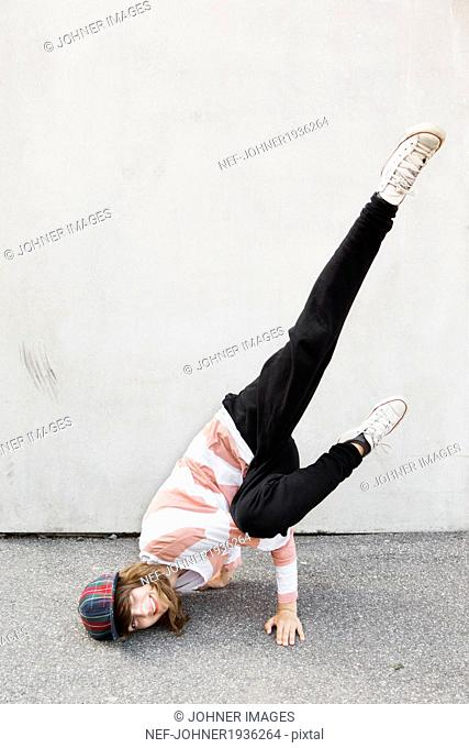 Happy teenage girl dancing, Stockholm, Sweden