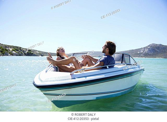 Couple sitting together in boat on water
