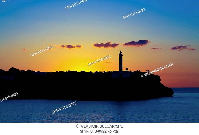 Silhouette of a lighthouse on the coast