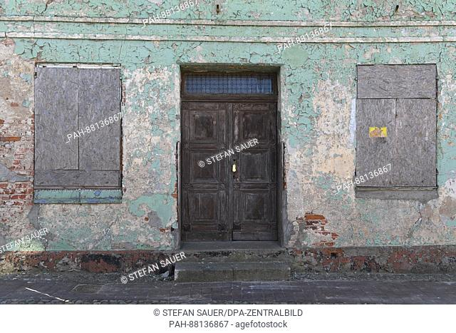 The facade of an unoccupied building in the centre of Wolgast, Germany, 15 February 2017. Wolgast is selling off housing stock in the historic centre of the...