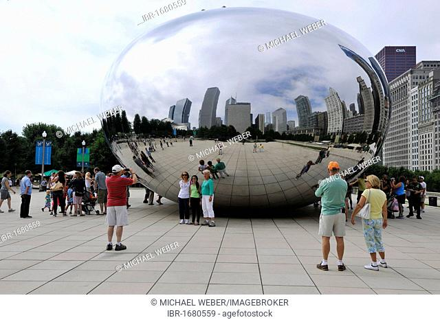 Tourists standing in front of the Cloud Gate sculpture, nicknamed The Bean, created by Anish Kapoor, AT & T Plaza, Millennium Park, Chicago, Illinois