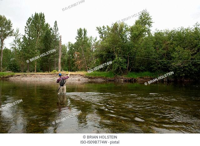 Man fishing in river, Clark Fork, Montana and Idaho, US