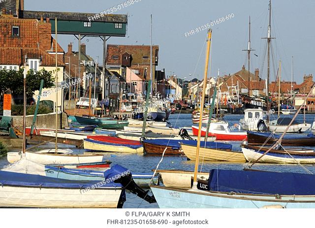 Boats in coastal town harbour at high tide, Wells-next-the-sea, North Norfolk, England, september
