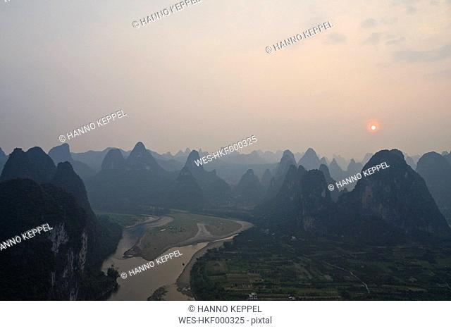 China, Xing Ping, View of river LI with rock formations