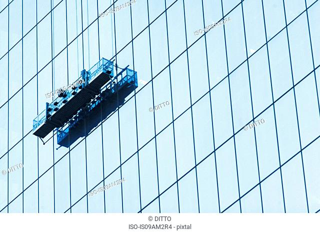 Suspended window cleaning platform on glass building