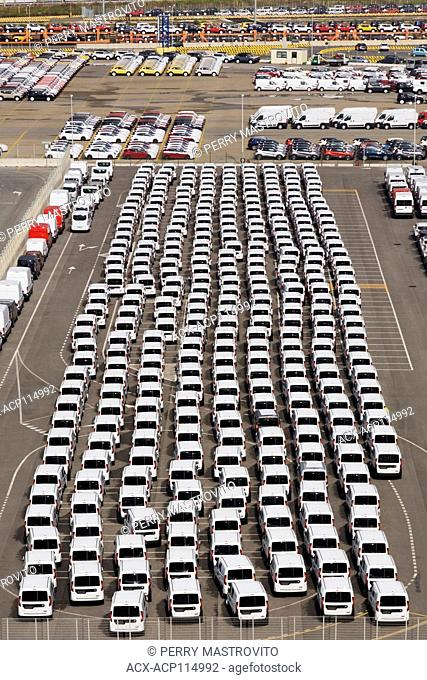 Top view of unloaded new motor vehicles in the port of Civitavecchia, Lazio region, Rome province, Italy, Europe