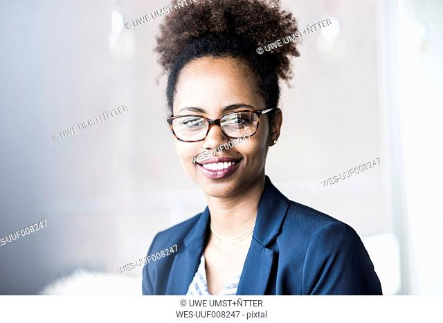 Portrait of smiling businesswoman wearing glasses