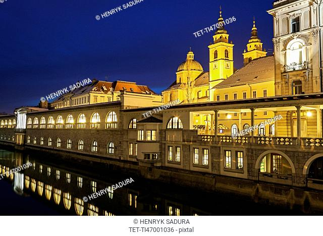 Illuminated waterfront with Saint Nicholas Cathedral