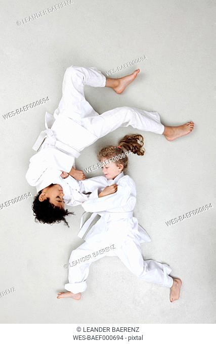 Boy and girl practicing judo