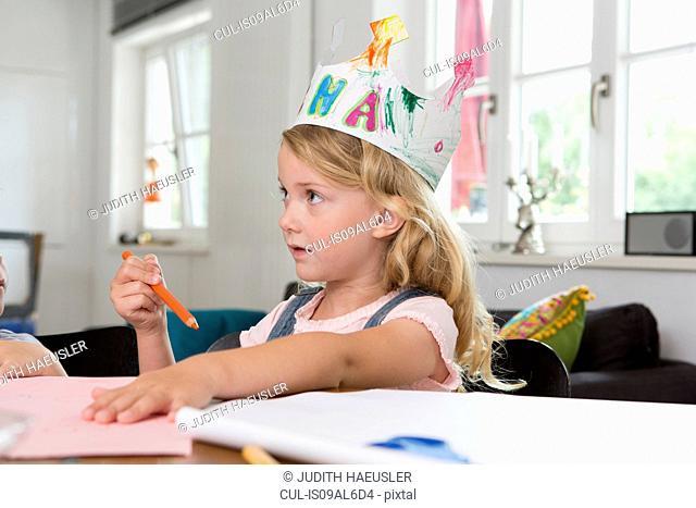 Girl wearing homemade paper crown