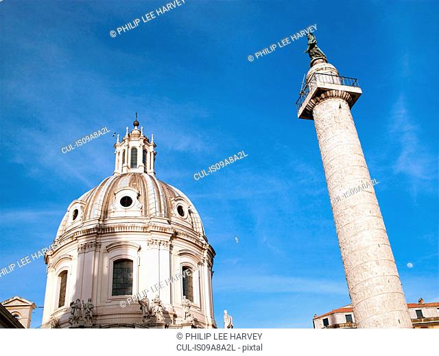 Trajan's Column with the dome of Santa Maria Di Loreto, Rome, Italy