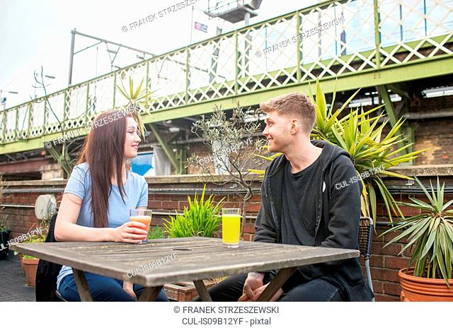 Young couple chatting on terrace