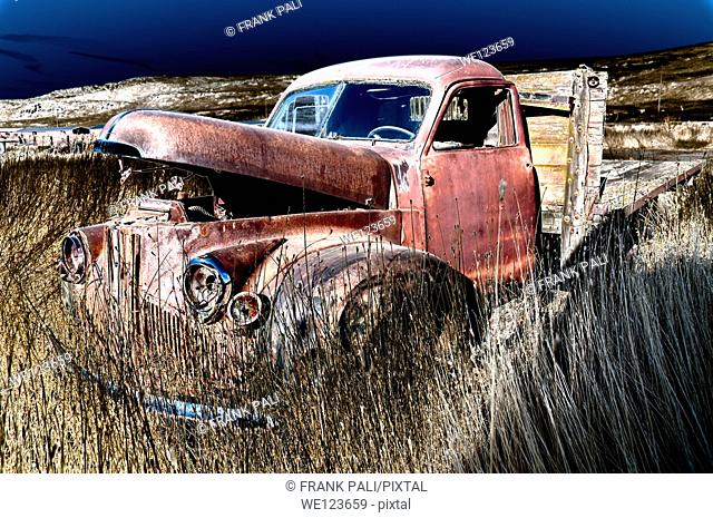 Old Pickup truck in farm field that has been solarized.South East Washington.USA