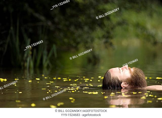 Head of Bearded Man floating in lake - Cedar Mountain, North Carolina USA